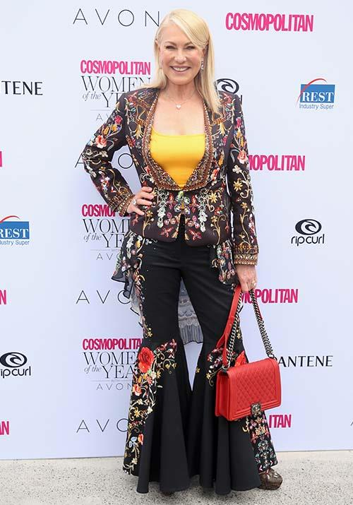 A kick and a flare did the trick for Kerri-Anne at the 2017 *Cosmopolitan* Women of the Year Awards. She can rock 70s fashion like no other!