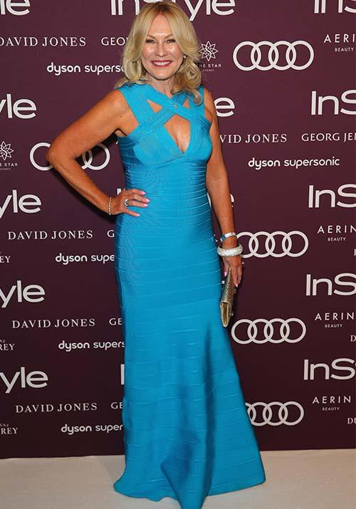 "Classy as ever, KAK opted for a [beautiful blue](https://www.nowtolove.com.au/celebrity/celeb-news/kerri-anne-kennerley-channel-10-husband-54859|target=""_blank"") body-con dress at the 2017 Women of Style Awards."