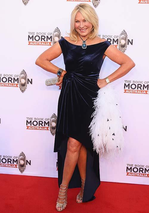 Attending the *Book of Mormon* opening night in 2018, Kerri-Anne pulled off evening-chic like a pro in this gorgeous midnight blue dress.
