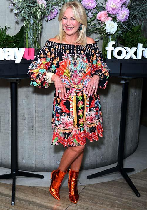In true KAK style, the stunning TV presenter spiced things up at *The Real Housewives of Beverly Hills* party, wearing this gorgeous printed frock and some daring orange metallic boots.