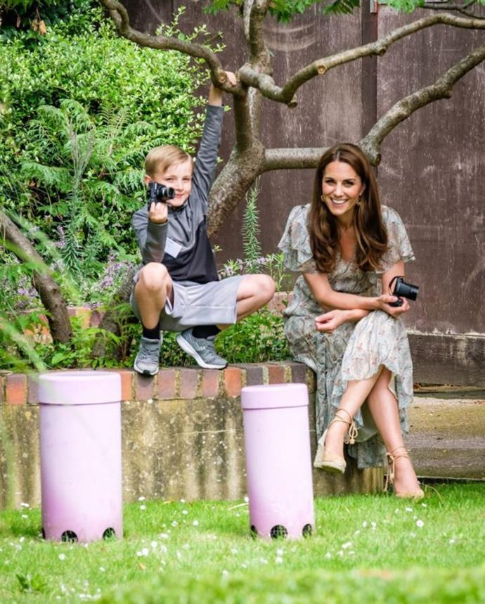 Duchess Catherine is pictured with budding photographer Josh Evans.