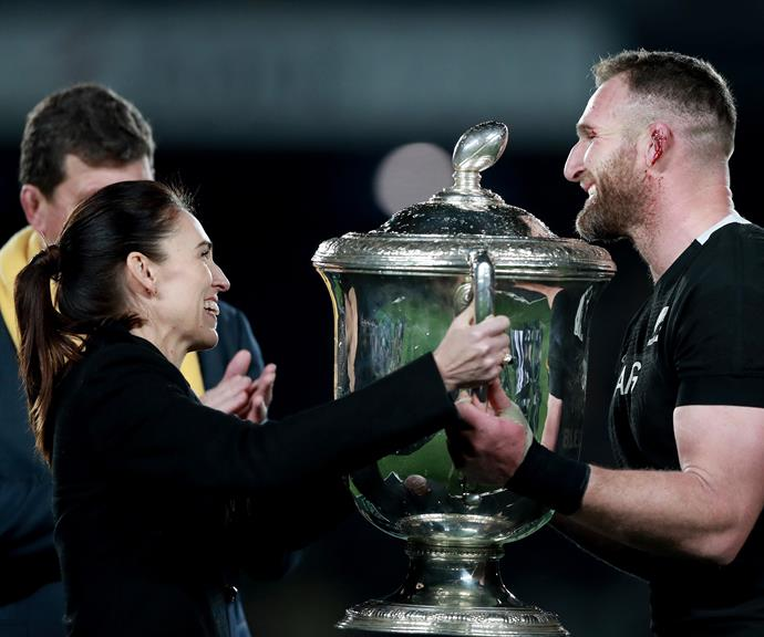 Jacinda Ardern presents the Bledisloe Cup to All Blacks captain Kieran Read on Saturday night.