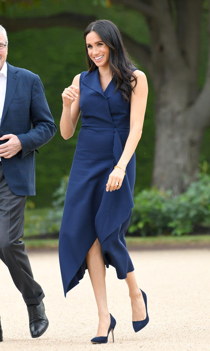 The stunning navy dress will go down as one of our favourite looks on the royal.