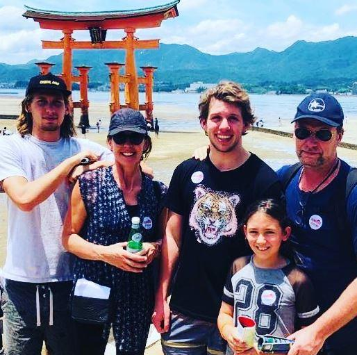 Janine and Jeff holiday in Japan, pictured here with three of their children.