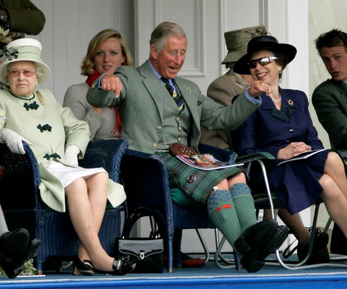 When your friends have a laugh at your expense! Prince Charles and Princess Anne chuckling together while the Queen seems very unamused, in 2010.