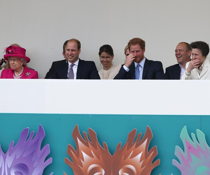 One is not amused! Prince William, Prince Harry and Princess Anne share a joke while watching a street party outside Buckingham Palace in 2016, but the Queen didn't seem to find it funny at all.
