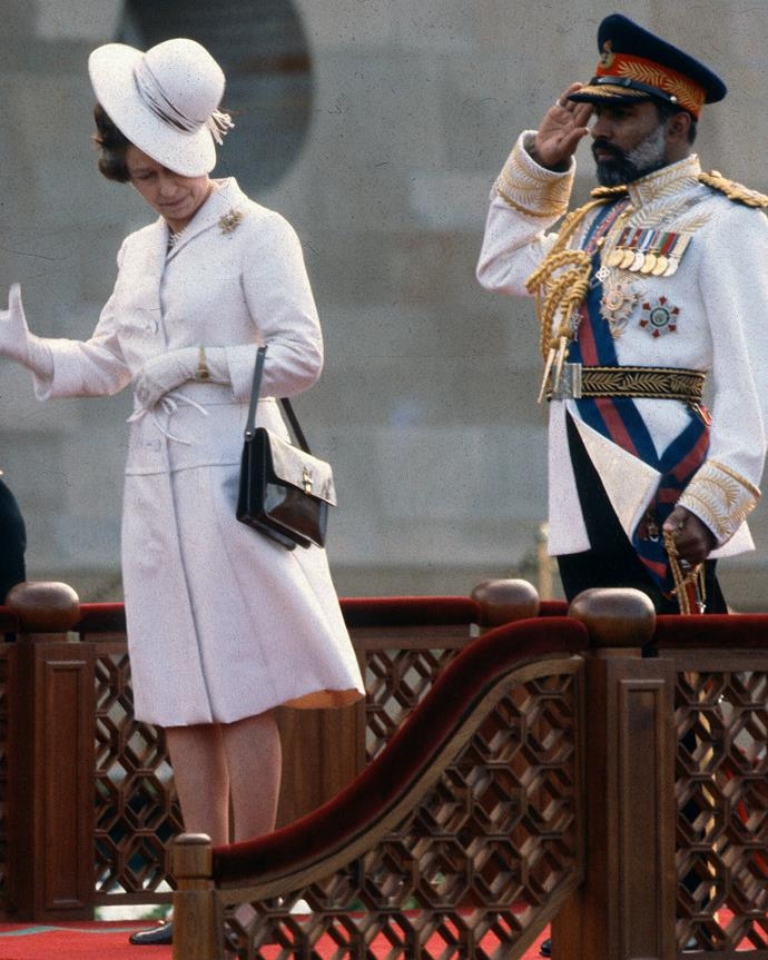 The Queen's hat blows off her head in a gust of wins during a welcome ceremony in Muscat, Oman, in 1979.