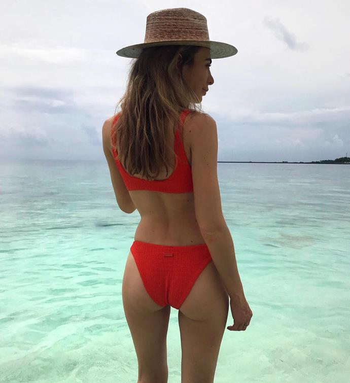 Nadia rocking a bright red bikini while on holidays recently.