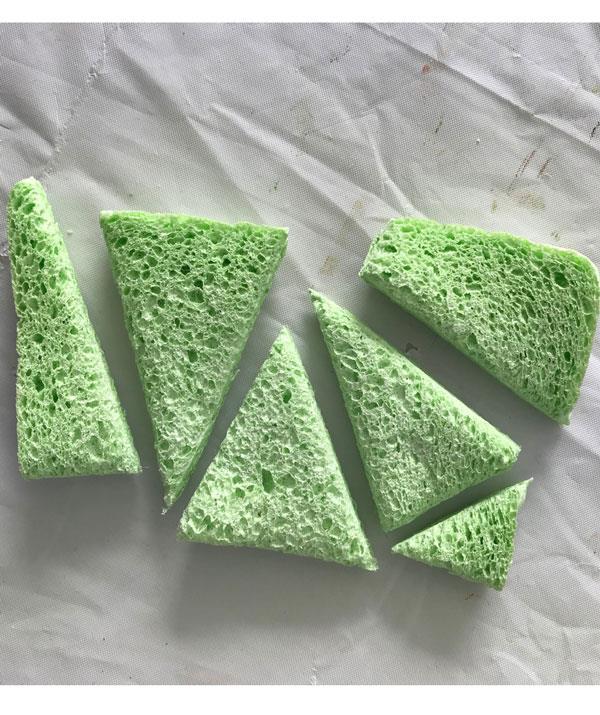 **STEP 2:** Use scissors to cut sponge into triangles.