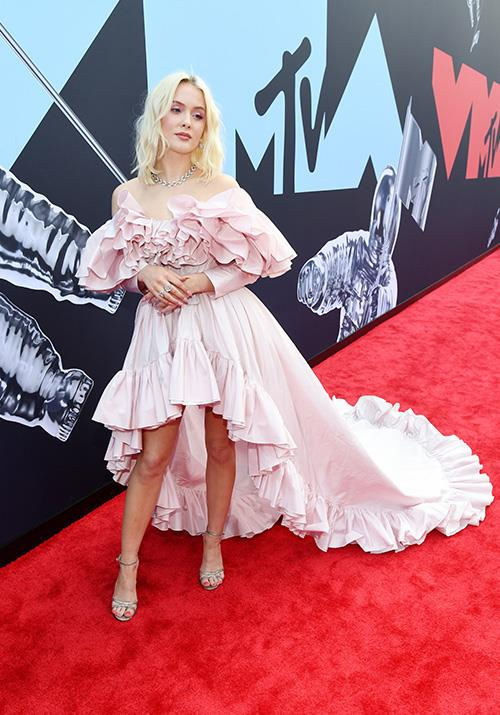 Singer Zara Larsson is pretty in pink with frills galore in this high-low number.