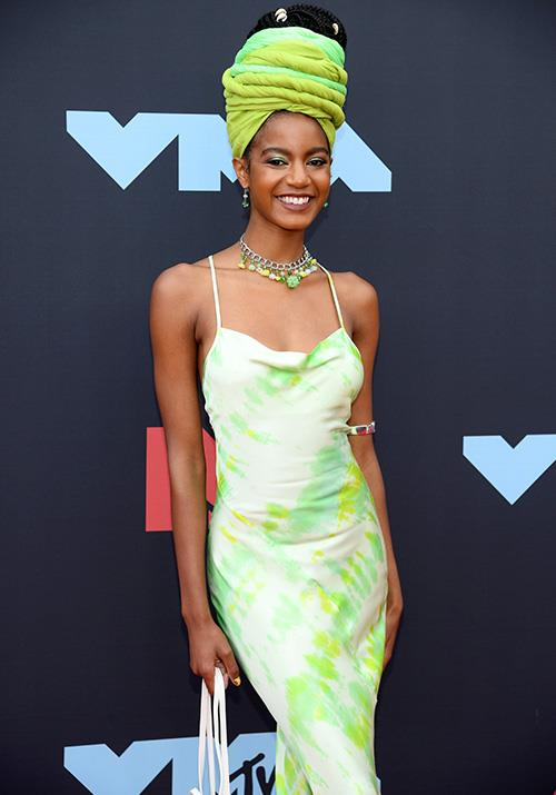 Stunning model Ebonee Davis looks incredible in this bright green slip dress - obsessed!