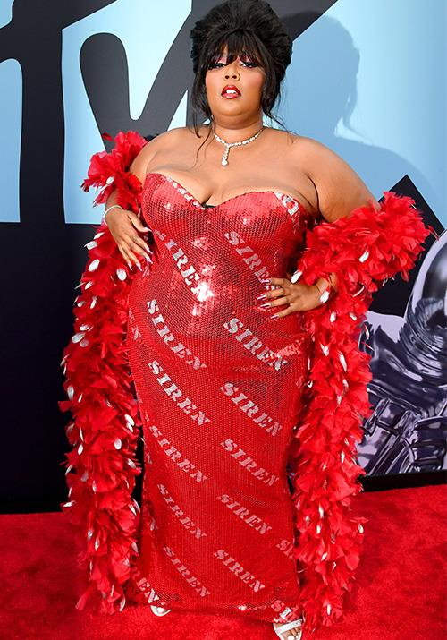 Melissa Viviane Jefferson, aka Lizzo has brought the entire night's worth of drama in the form of this raven red gown. All we can say is wow.