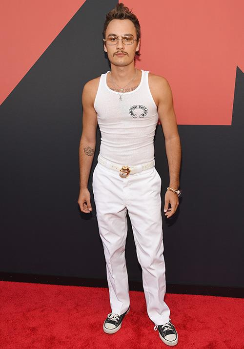 Yep, *The Hills* star Brandon Lee is wearing Chuck Taylor's on the red carpet. He also appears to have grown a handlebar moustache. Wonder how his mum Pamela Anderson feels about that...