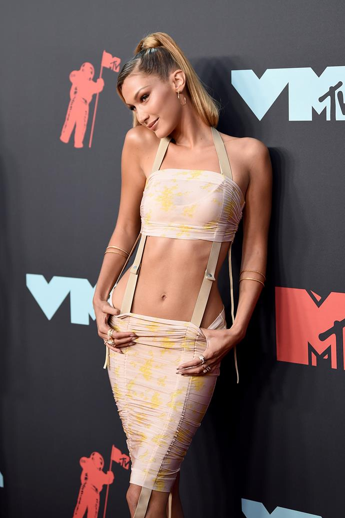 Is it a crop top? Is it suspenders? Is it a suspender-crop-top-overall-extravaganza? We have no idea. Stunning model Bella Hadid looks good in anything though!