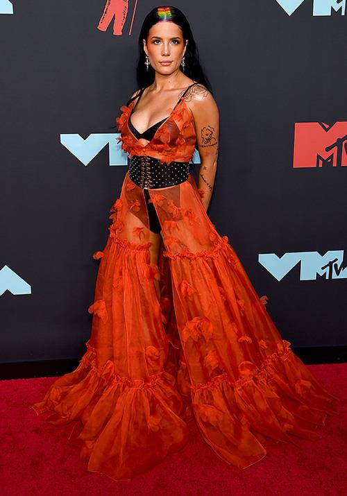 Singer Halsey looks almost ethereal in this floaty sheer orange dress - but the visible underwear definitely makes it a *little* more risqué. Loving the subtle rainbow addition, too!