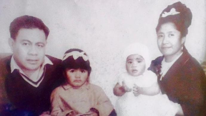 Me as a baby with my parents and my big sister Mireta.