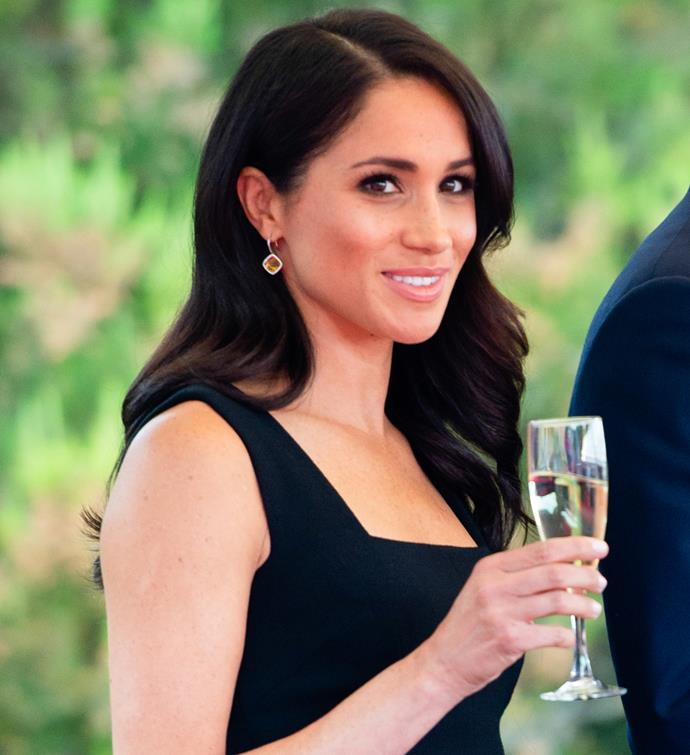 Meghan looked absolutely stunning at the event - and appeared to be enjoying her Champagne too.
