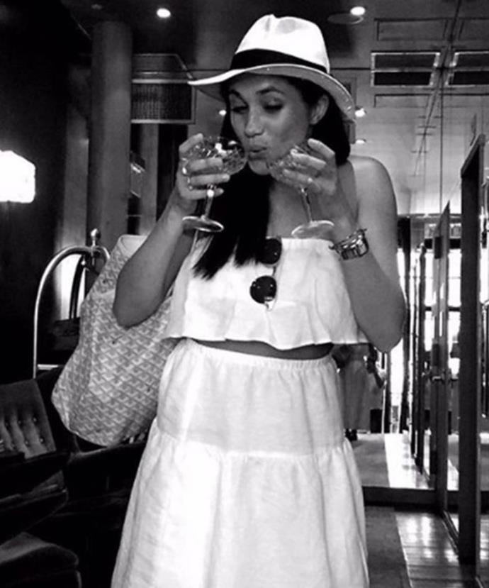 "This old photo from [Meghan's old Instagram account](https://www.nowtolove.com.au/royals/british-royal-family/meghan-markle-instagram-52738|target=""_blank"") shows her tucking into a couple of glasses of wine."