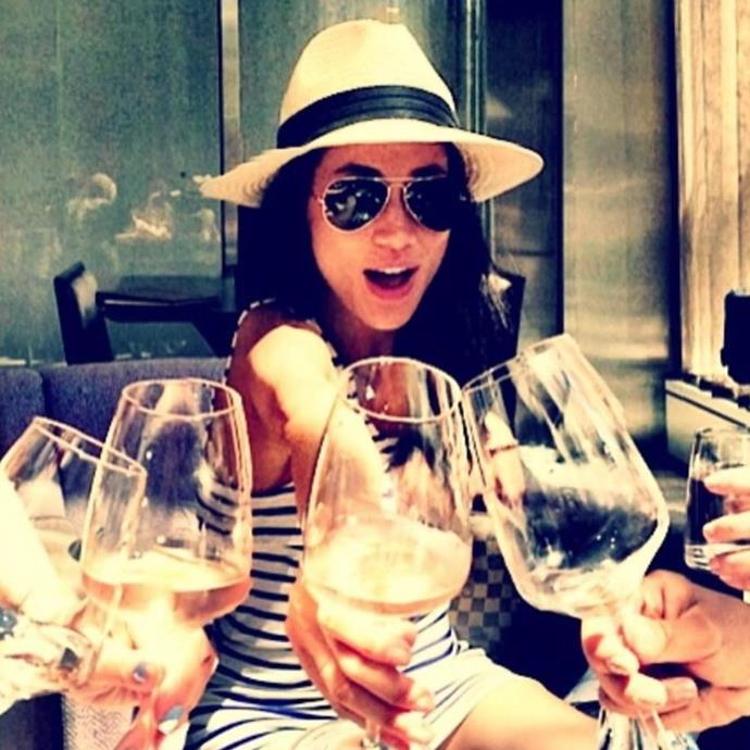 Another unearthed photo from Meghan's now deleted page reveals her enjoying a wine with friends.
