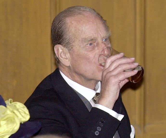 Prince Philip tucking into a beer.