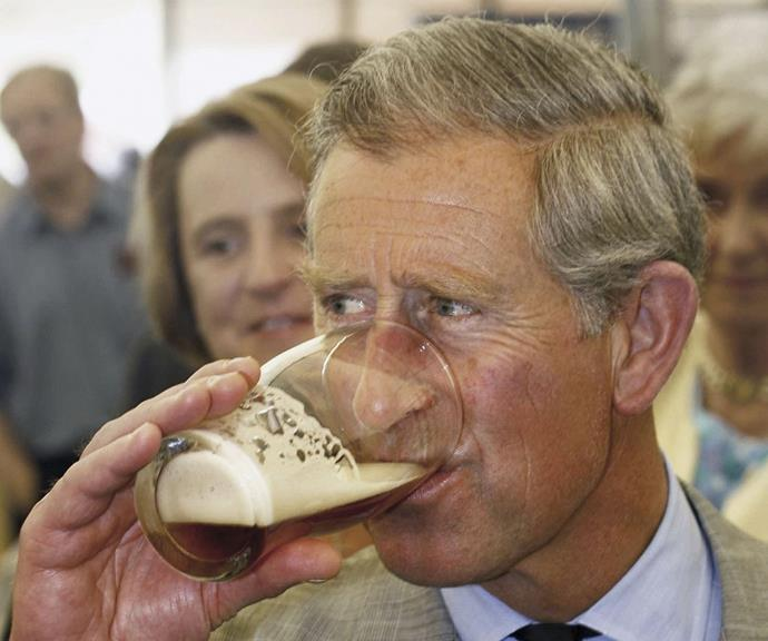 Prince Charles finishes his beer.