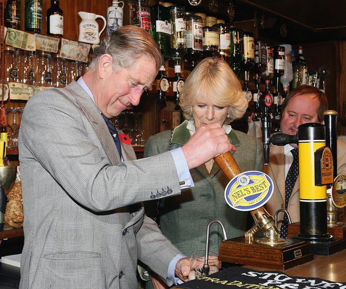 Prince Charles and Duchess Camilla proving they can pull a beer like nobody's business.