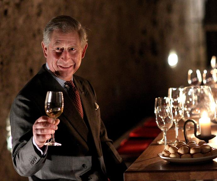 Cheers, Your Highness! Prince Charles takes part in a toast.