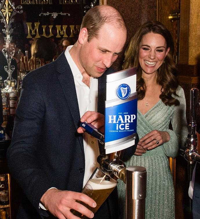 Duchess Catherine and Prince William serve beers at a pub in Belfast in February this year.