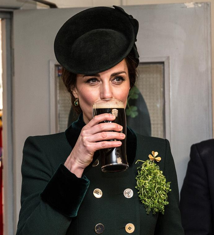 Kate drinks a glass of Guinness while on tour in Ireland.