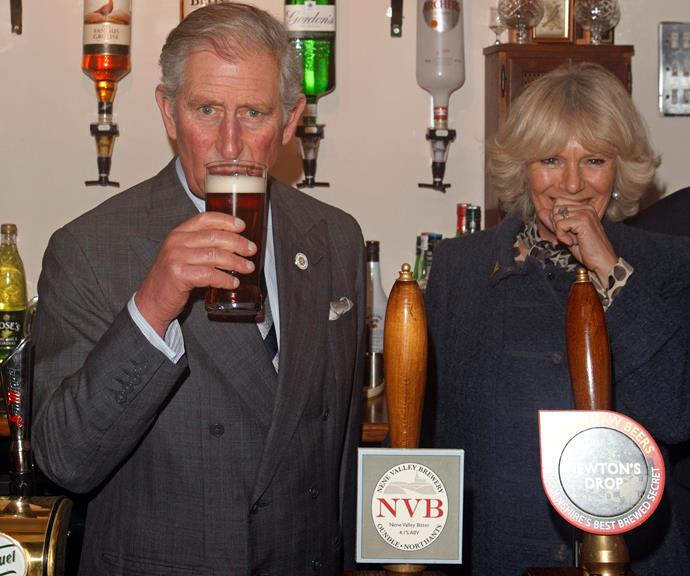 Charles and Camilla enjoying a cheeky moment together at the pub.