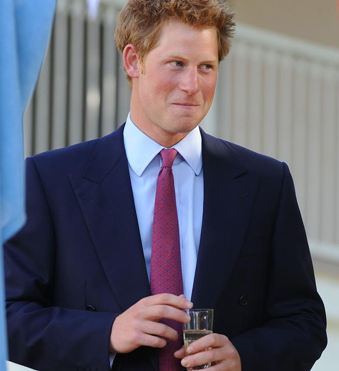 A young Prince Harry drinking a glass of Champagne in 2010 at the British High Commission in Gaborone, Botswana.