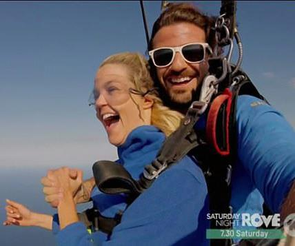 Is she happy because she's skydiving, or because she's holding hands with the hot skydiver guy?
