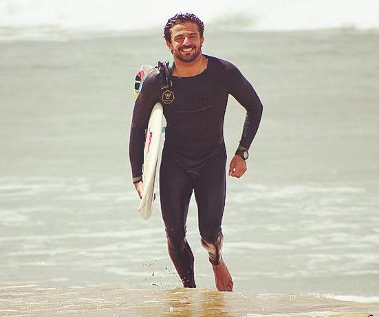 Charly rocking the hell out of that wetsuit.