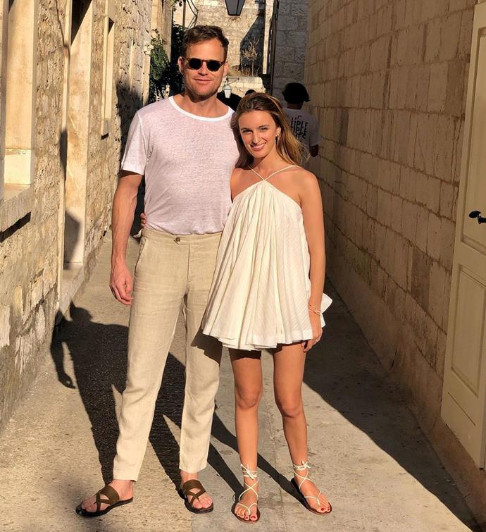 Claudia looked stunning in a simple white halter-neck dress, while Tom dressed for the weather in head-to-toe neutral linen.