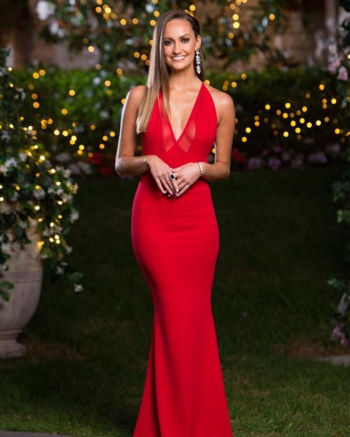 It's as if the emoji has come to life! Emma's blending in with the roses in this stunning red gown.