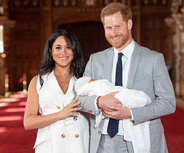 Meghan and Harry pose with baby Archie during the official media photocall.