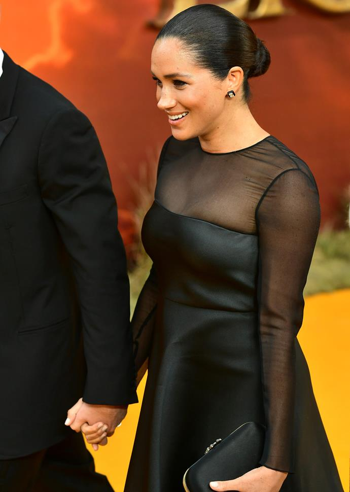 Meghan showing off her postpartum body on the red carpet.