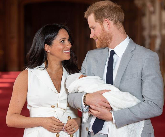 Harry and Meghan pose with baby Archie in May, just days after he was born.