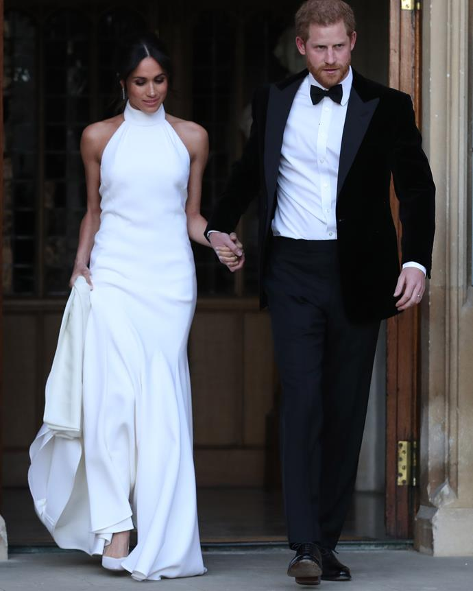 Meghan and Harry on their way to their wedding reception in 2018.