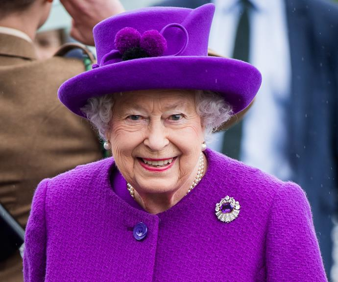 The Queen looks gorgeous in a bright purple jacket and matching hat.