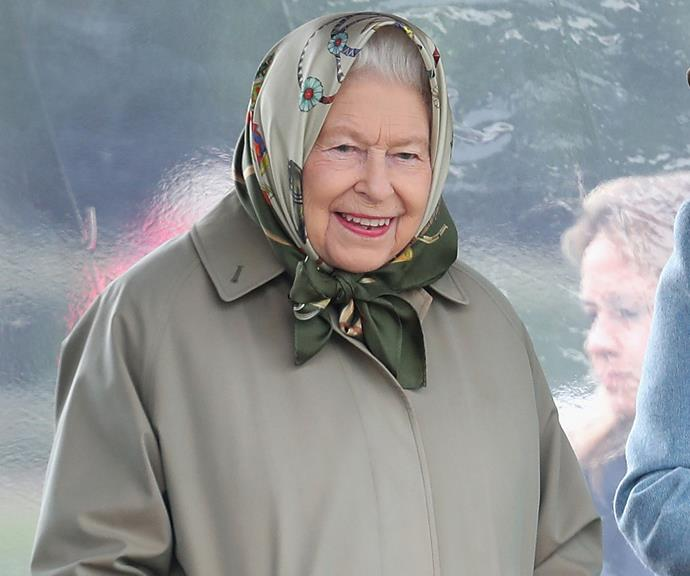 Her Majesty going under the radar in a neutral beige-green coat and matching silk headscarf, relaxing at home.