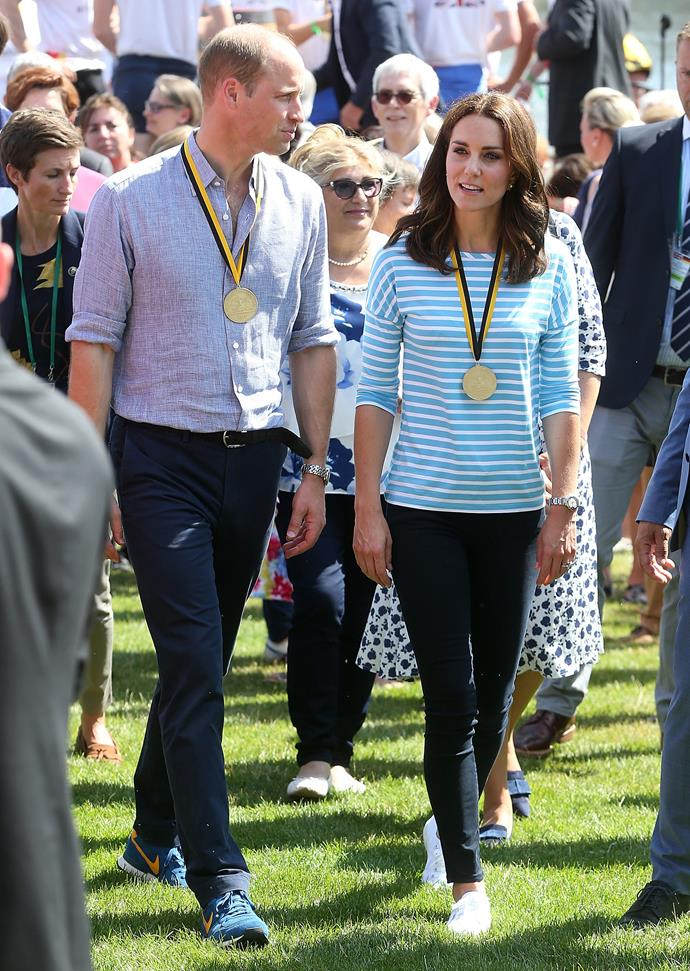 Kate and Wills are peak smart casual in their jeans, sneakers and nice tops.