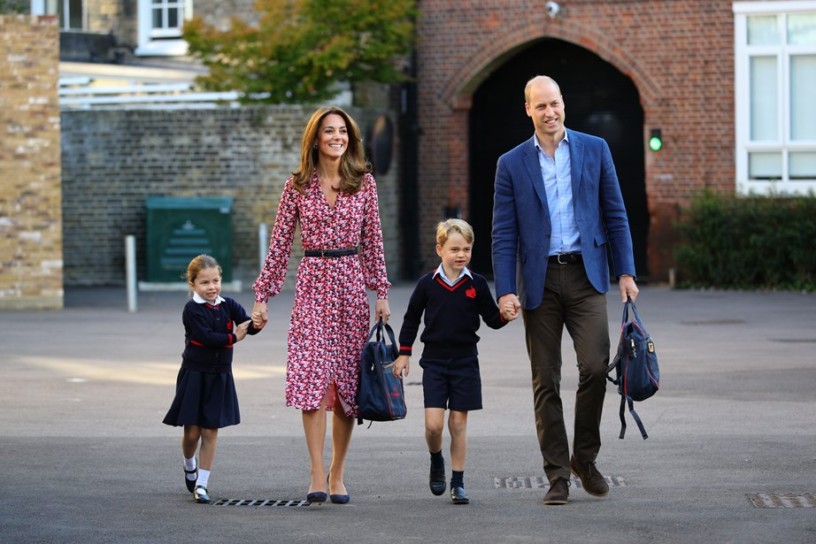 Princess Charlotte held onto her mother's hand as she made her way to her first day of school, joined by Prince George and William. *(Image: Getty)*