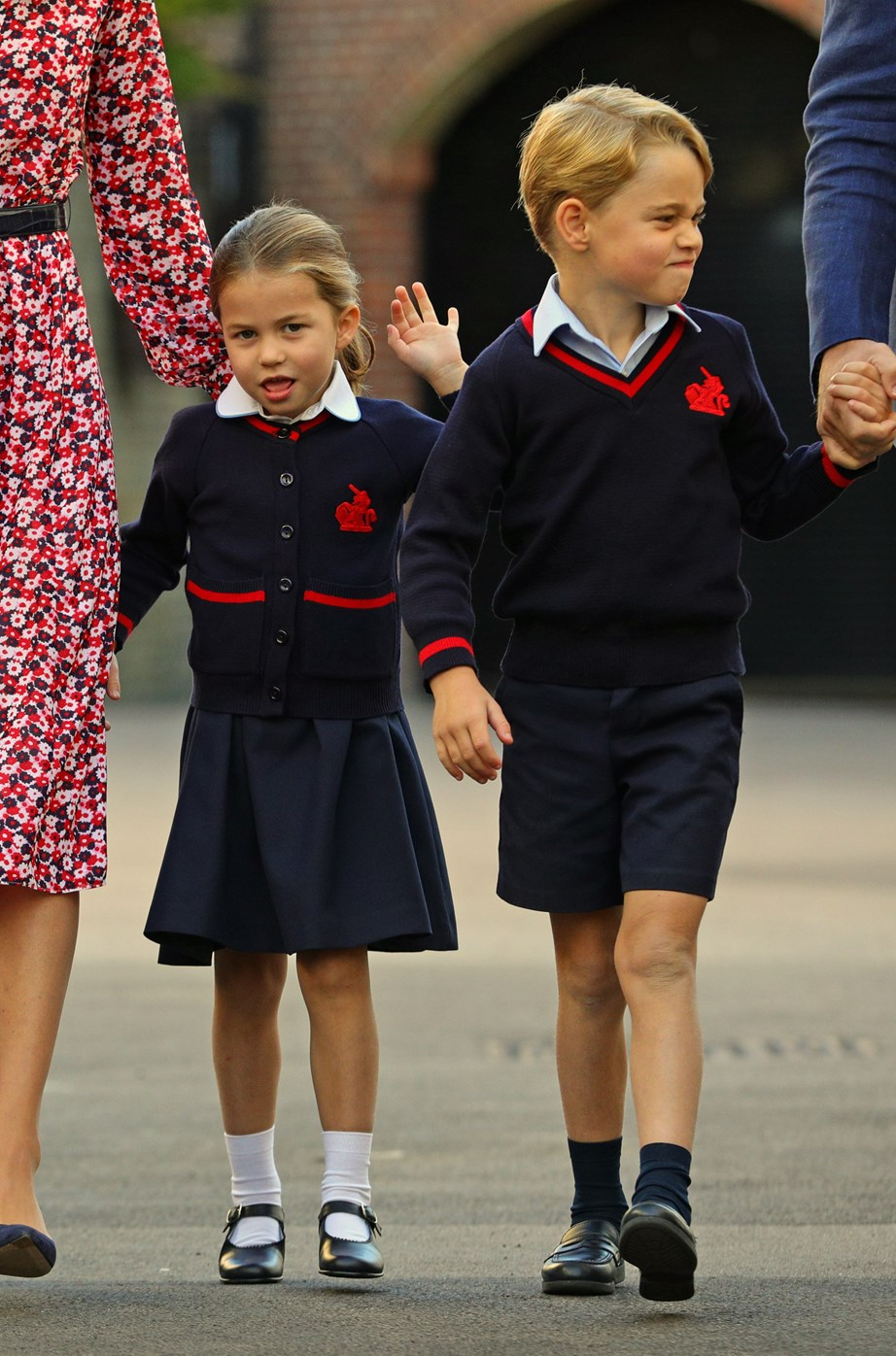 Princess Charlotte waves to the press. *(Image: Getty)*
