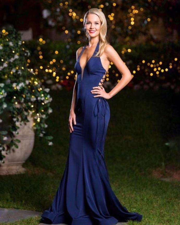 We're not sure how to feel about the criss-cross lace up at the back of Helena's midnight blue gown.