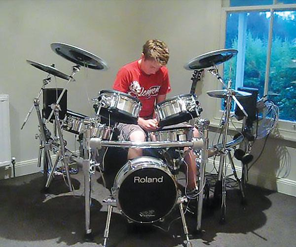 Thomas loved playing drums.