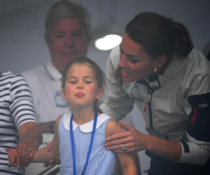 Charlotte sticking her tongue out at her grandmother, Duchess Catherine's father Michael Middleton.