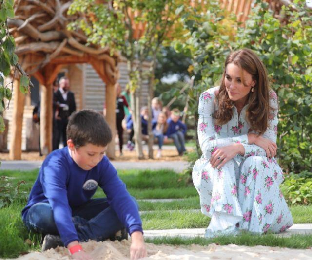 Kate watches as a child plays in the sandpit.