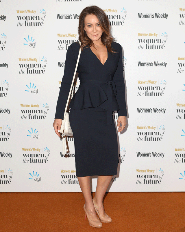 Michelle Bridges' navy peplum dress is a bold and gorgeous choice for the red carpet. **WATCH NEXT: Michelle Bridges at the Australian Women's Weekly Women of the Future Awards.**