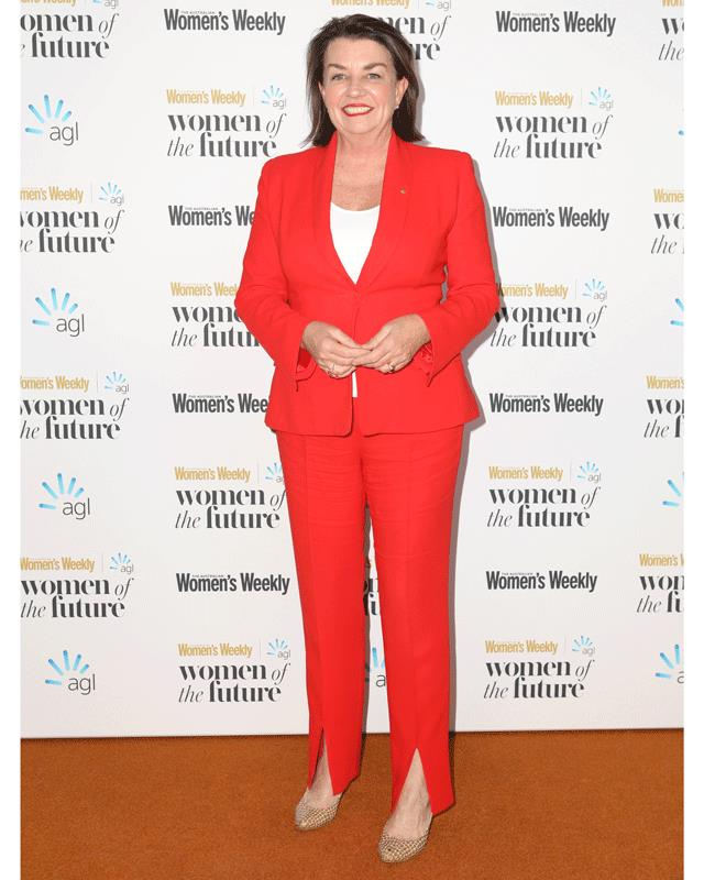 Former Queensland Premier Anna Bligh looks chic in a red suit.